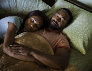 Mid-adult couple sleeping --- Image by © Tim Pannell/Corbis